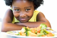 Girl and Plate of Vegetables